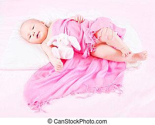 Sweet newborn baby with soft toy