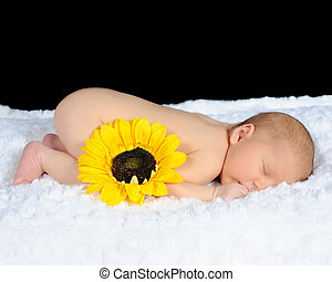 sweet newborn sleeping peacefully on a white blanket