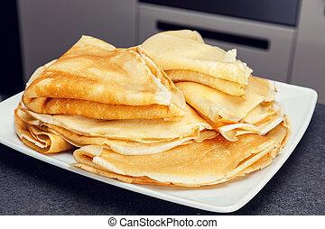 Sweet pancake on white plate