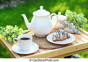 Sweet pastry with a cup of coffee