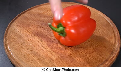 Sweet pepper on a cutting board. Slow motion - Cook scrolls...