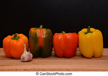 Sweet pepper on a wooden table