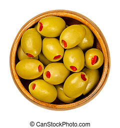 Sweet pepper stuffed green olives in wooden bowl