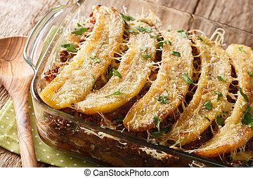 Sweet Plantain Lasagna close-up in a baking dish. horizontal