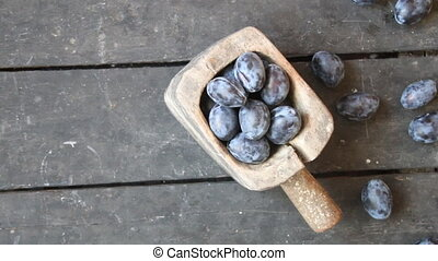 Sweet plums, food background - Plums on an old rustic table....