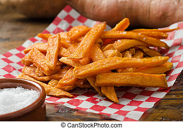 A serving of delicious deep fried sweet potato fries.