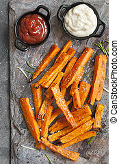 Sweet Potato Fries Top View on Slate with Ketchup and Mayonnaise