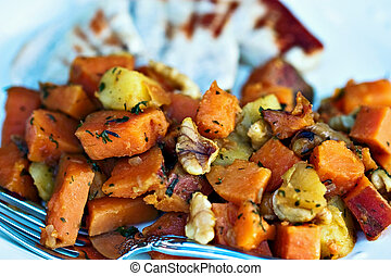 Sweet potato hash with grilled turkey. Shallow DOF with focus on potatoes.