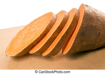 Sweet potato over a wooden board
