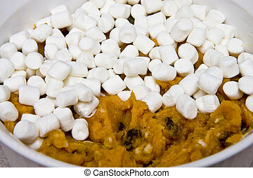 Sweet Potato Souffle - A sweet potato souffle topped with...