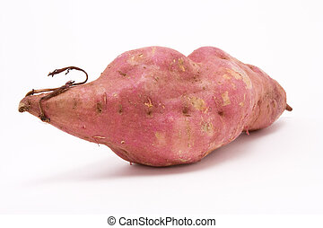 Sweet potato against white background from low perspective.