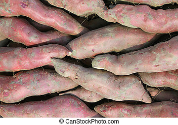 Sweet potatoes backgrouns - Sweet potatoes background. ...