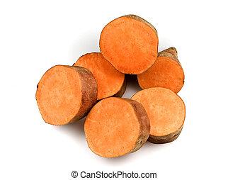 Sweet potatoes - Cuts of an orange sweet potato on a white ...