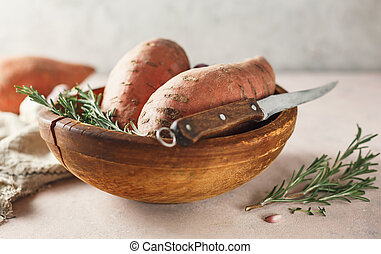 Sweet potatoes in a large wooden bowl