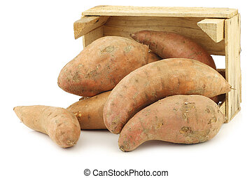 Sweet potatoes in a wooden crate