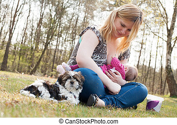 Sweet puppy while mother is feeding her daughter