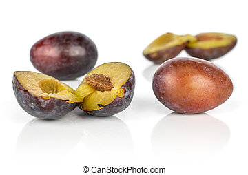 Sweet purple plum isolated on white