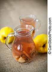 quince compote - sweet quince compote in a carafe on the ...