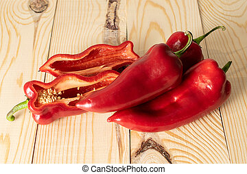 Sweet red bell pepper on wood