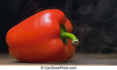 sweet red bell pepper or capsicum is on the table in cold,...