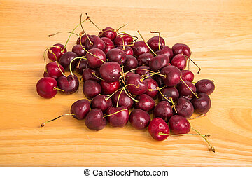 Sweet Red Cherries on a Wood Table