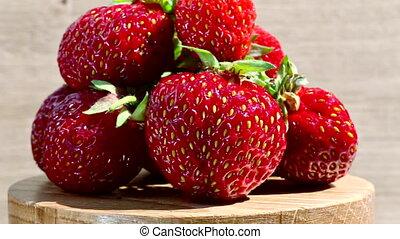 strawberries on rotating plate - Sweet red fresh...