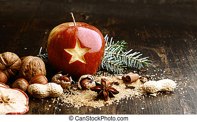Sweet Red Holiday Apple with Nuts on Wooden Table.