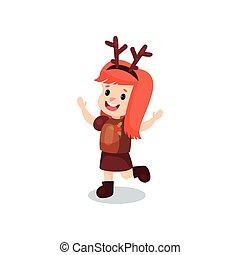 Sweet redhead little girl in the costume of reindeer, kid in...