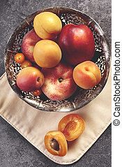 Sweet ripe peach in the bowl
