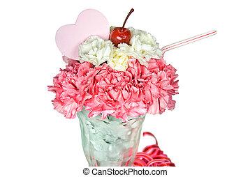 Pink heart in carnation sundae on white.