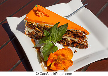 Sweet slice of carrot cake on a white plate
