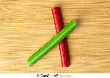 Sweet stick candy on light wood