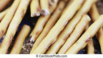 Sweet straw in bulk - On a scattering of bread crumbs in...