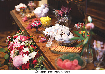 Sweet table with marshmallows, marmalade, cookies and sweets. Candy bar.