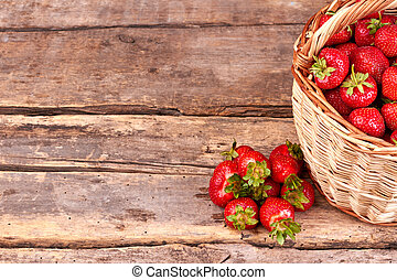 Sweet tasty strawberries on rustic wooden background.