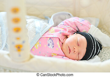 newborn sleeping in the crib