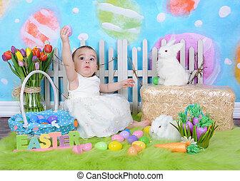 sweet toddler girl in easter scene