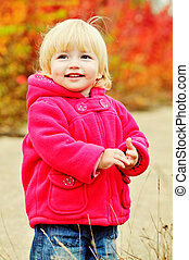 sweet toddler in fall time