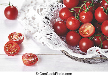 Sweet tomatoes on the white wood