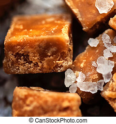 Salted caramel pieces and sea salt close up