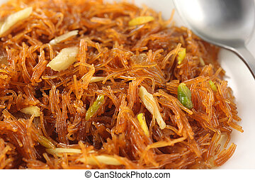 Sweet vermicelli close up on a white plate