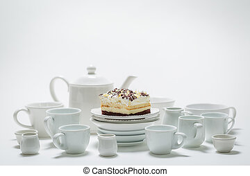 Sweet white cake with mousse, chocolate and porcelain