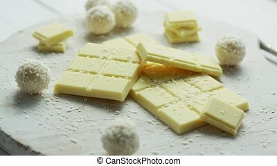 Sweet white chocolate with coconut sweets - Closeup of...