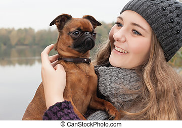 Sweet winter teenager and her dog