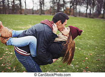Sweet young couple sharing a kiss while on a date
