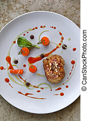 Sweetbread, carrots and juice on a plate