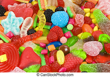 Sweetened assortment of multicolored candies - Close view of...