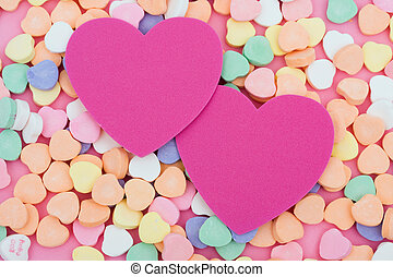 Candy hearts with two blank paper hearts