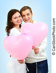 Sweethearts - Portrait of two young people holding...