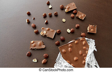 milk chocolate bar with hazelnuts in foil wrapper